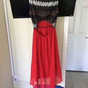 Red sequinned high low dress
